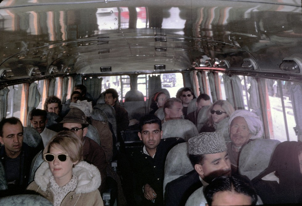"""Peg Podlich, in the sun glasses, taking a family trip on a bus going from Kabul, Afghanistan to Peshawar, Pakistan. """