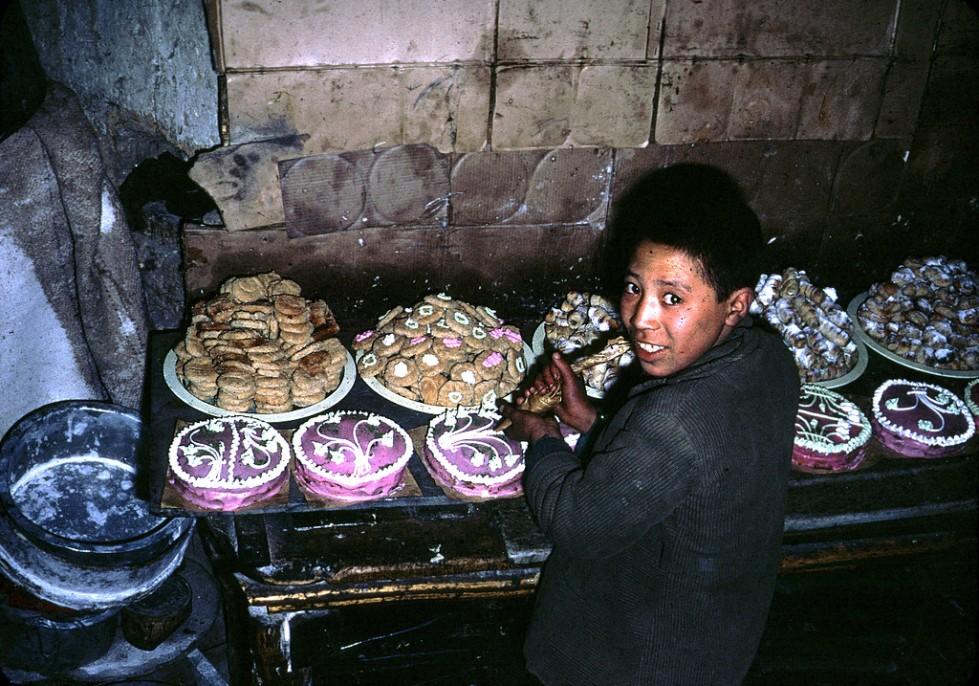 """An Afghan boy decorates cakes. """